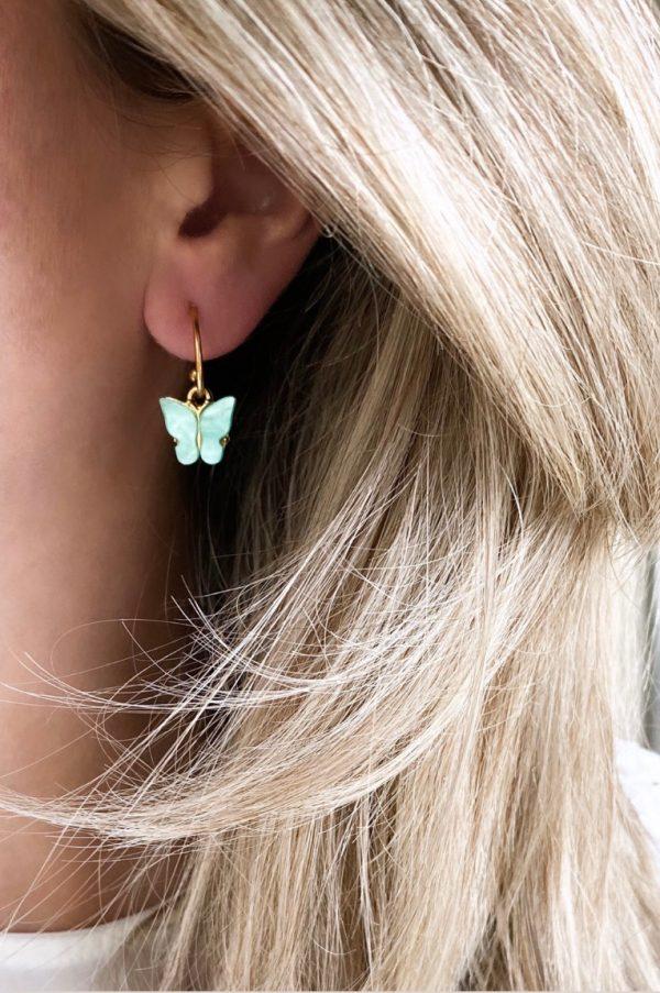 la Beij Oorbellen Goud Vlinder Blauw in oor